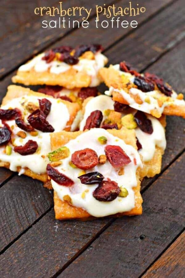 Cranberry Pistachio Saltine Toffee recipe #christmascandy #saltinetoffee #crackertoffee #candy #dessert #christmasbaking #holidays