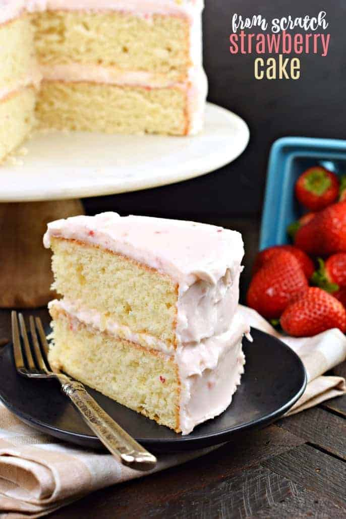 This delicious, from scratch, Strawberry Layer Cake has a scrumptious buttercream frosting made with Promised Land Dairy Very Berry Strawberry Milk and fresh strawberries! One bite and you'll never make a boxed cake ever again!