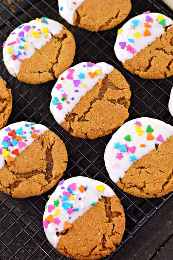 Chewy Gingerdoodle Cookies dipped in white chocolate with pastel sprinkles.