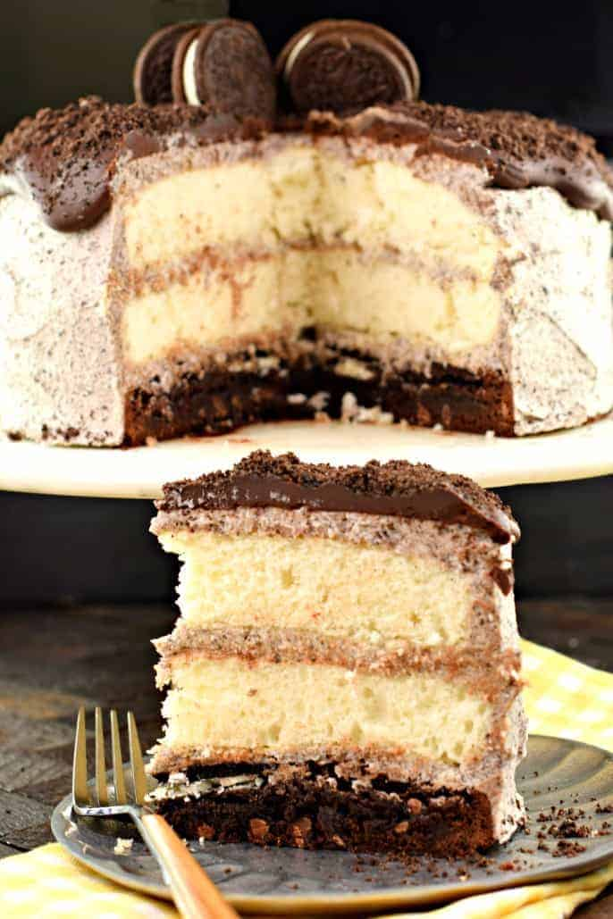 Oreo Brownie Cake is a decadent treat with three layers! Starting with a brownie base and topped with two layers of white cake, this cake is covered with Oreo frosting and chocolate ganache!