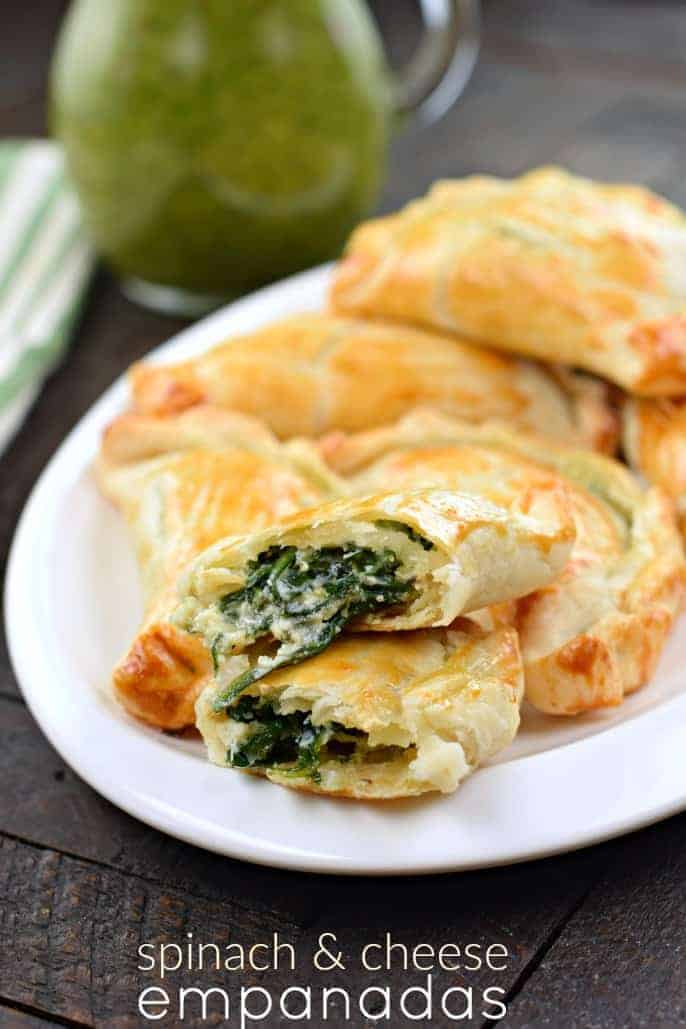 Flaky pie crust filled with fresh spinach, garlic, and ricotta cheese. These Spinach and Cheese Empanadas are an easy dinner or appetizer recipe, and best served with fresh Chimichurri sauce!