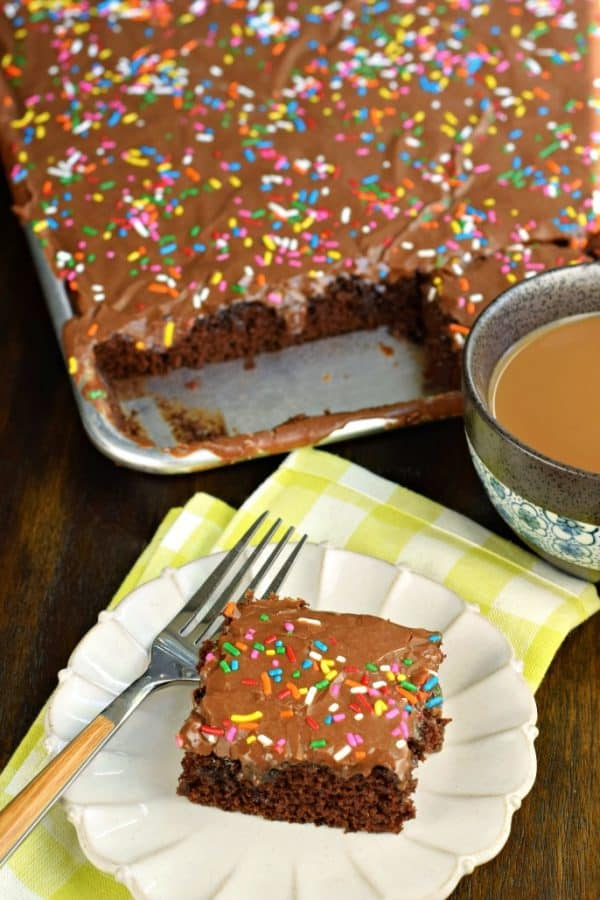 Easy one bowl Chocolate Buttermilk Sheet Cake recipe. Fudgy buttermilk frosting on top! Perfect for a crowd, or freeze for later.