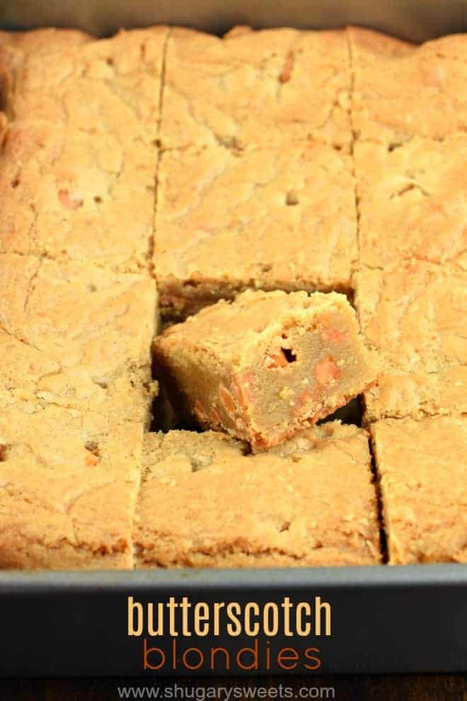 Blondies in a metal 13x9 baking dish, with one square lifted.