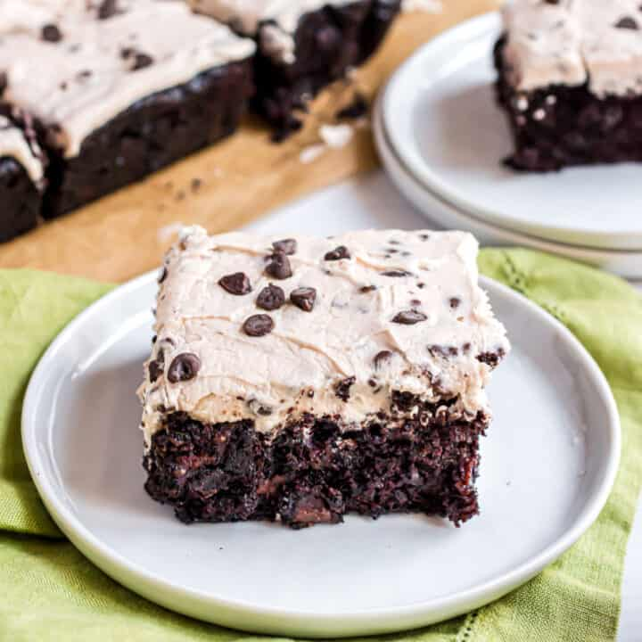 These Chocolate Chip Zucchini Brownies are the perfect way to sneak veggies into dessert. The zucchini makes these brownies fudgy and moist, and the chocolate chip frosting is the perfect topping!