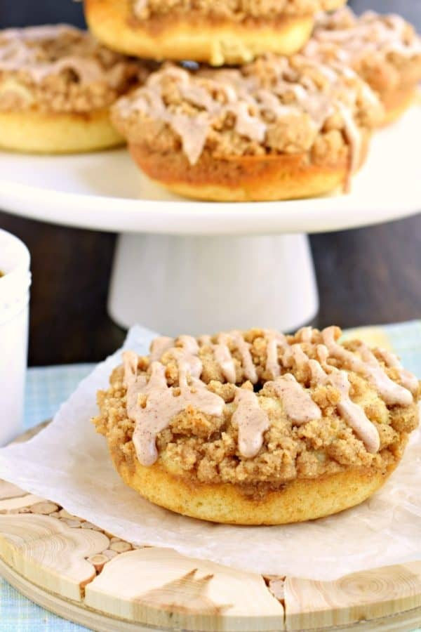 Tender, moist Cinnamon Coffee Cake Donuts with a chunky cinnamon streusel and sweet cinnamon glaze. Baked, not fried, and perfect for a delicious Saturday morning breakfast!