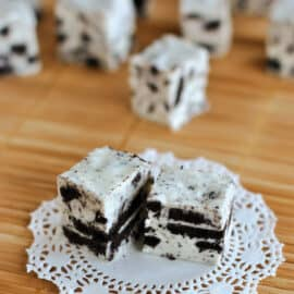 An easy, decadent Cookies and Cream Fudge recipe! This Oreo Fudge is packed with flavor and real Oreo cookie pieces. It's a delicious treat or homemade gift idea for any occasion!