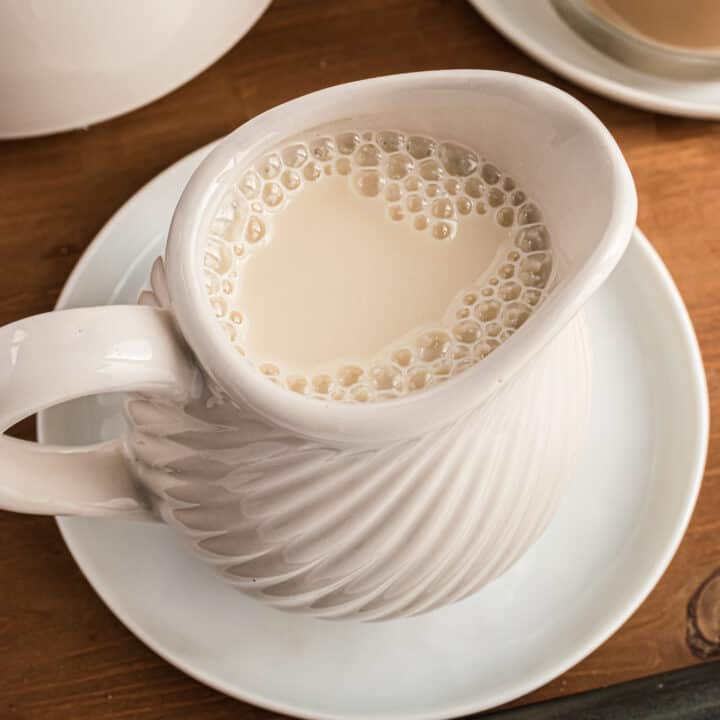 Homemade coffee creamer in a white pitcher.