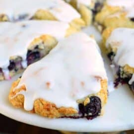 Light and fluffy, these Blueberry Lemon Scones are the perfect breakfast idea! Topped with a sweet lemon glaze, you won't be able to resist them!
