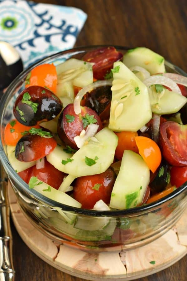 Healthy and light, this fresh Cucumber Tomato Salad is a delicious summer side dish!