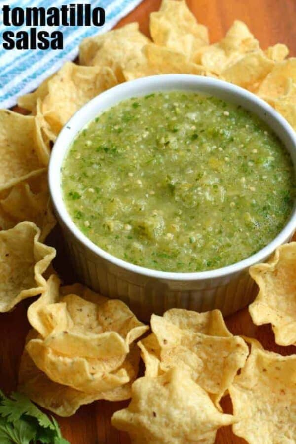 Try this Tomatillo Salsa recipe for an authentic, tangy Mexican salsa verde. Perfect for pairing with tacos, enchiladas or a big bowl of chips! #tomatillosalsa #salsaverde #gameday #tortillachips #snacks #salsa