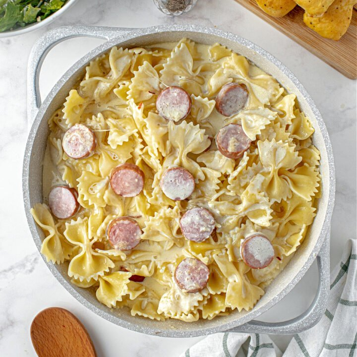 Creamy, Sausage Alfredo Pasta is a quick and versatile dinner recipe that is on the table in under 30 minutes! Noodles are tossed in a hearty, cheesy, alfredo sauce and sausage for an easy, satisfying meal.