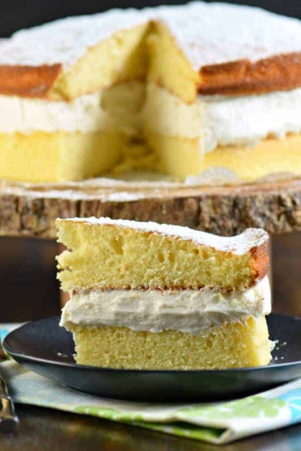 Delicious Twinkie Cake made with yellow cake and sweet whipped cream filling. The perfect, not overly sweet, cake recipe! #twinkie #copycatrecipe #yellowcake