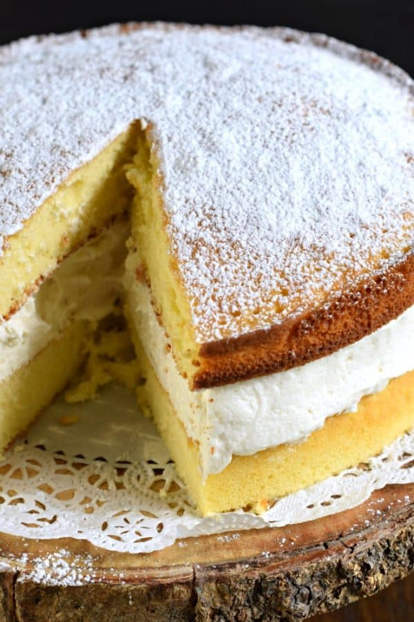 Two yellow cakes with vanilla cream filling make the most incredible copycat Twinkie Cake #dessert