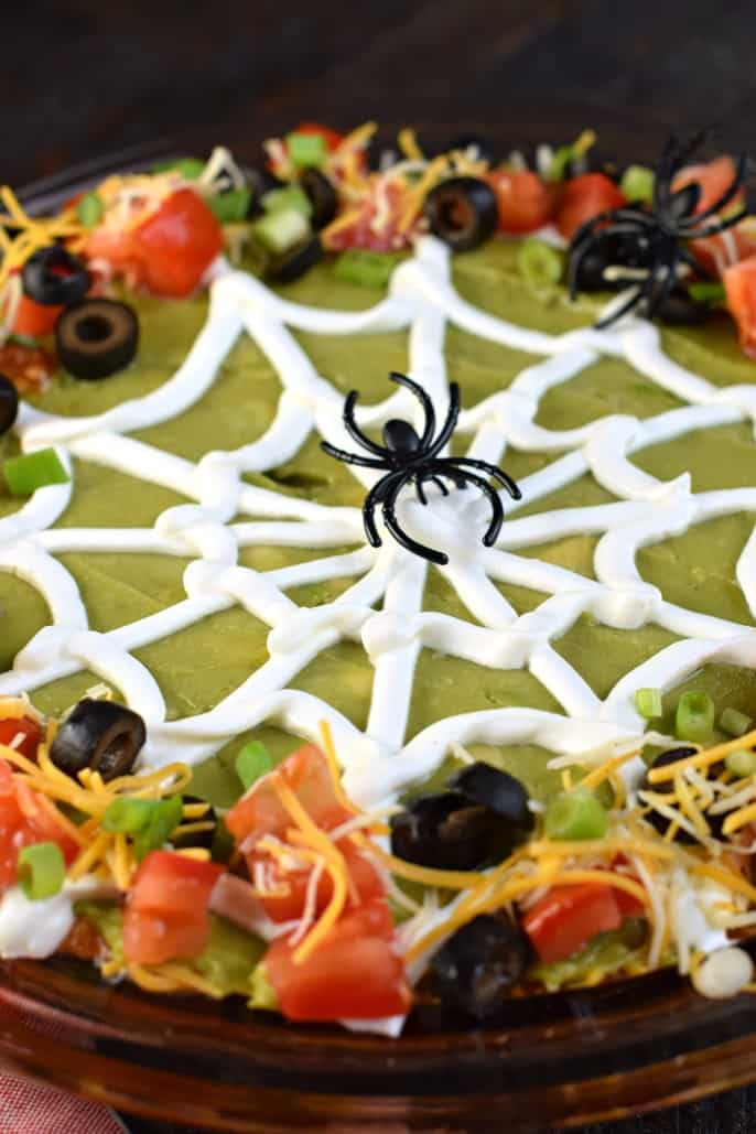 Taco Dip decorated to look like a spider web for Halloween.