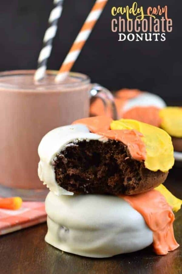 Candy Corn Chocolate Donuts: baked chocolate donuts with a festive #Halloween frosting! #spookytreats #milklife #halloweenparty #donuts #chocolate