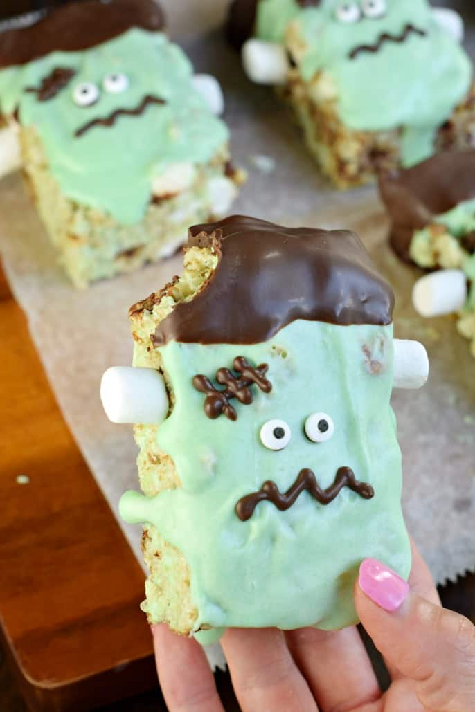 Mint chocolate chip Frankenstein rice krispie treat with one bite removed.