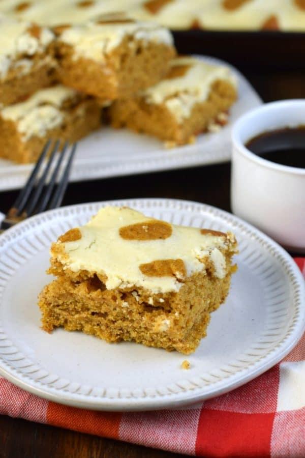 Tender, moist pumpkin cake topped with cheesecake. These Pumpkin Cheesecake Bars are the perfect fall dessert.