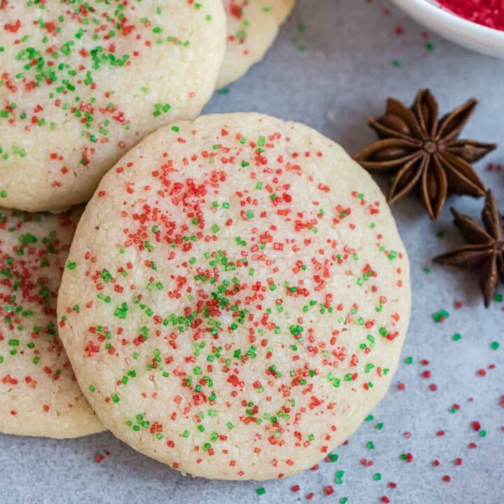 Jingles Cookies: sweet shortbread cookies with anise extract. You'll love these melt in your mouth Christmas cookies covered in red and green sprinkled!
