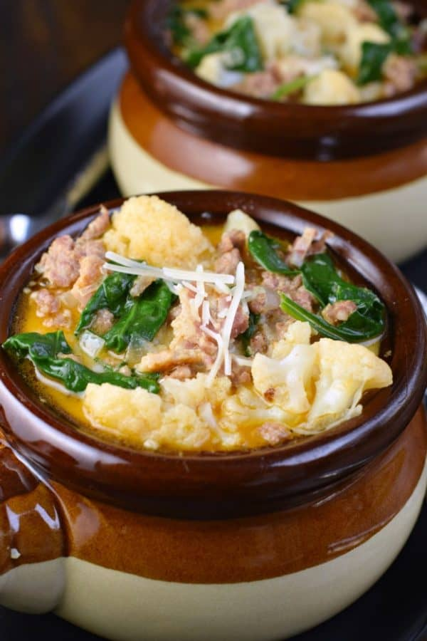 Bowl of Low Carb Zuppa Toscana Soup with cauliflower and spinach #keto #ketofriendly #lowcarb
