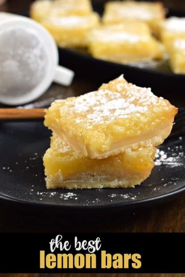 The Best Lemon Bars made with a shortbread crust and lemon filling. Topped with glaze AND powdered sugar.