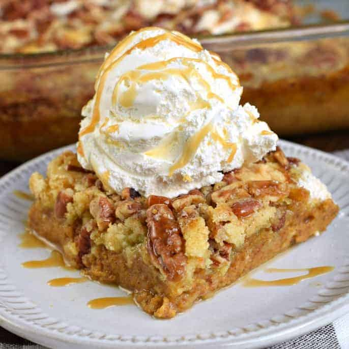 Sweet and Salty, you'll love this Pumpkin Crunch Cake recipe. With layers of pumpkin pie, yellow cake mix, and pecans, this pumpkin dump cake is a tried and true crowd pleaser! #thinkfisher #pumpkincake #thanksgiving