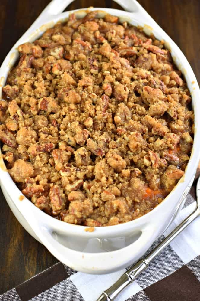 Sweet Potato Casserole with Streusel topping in an white oval baking dish.
