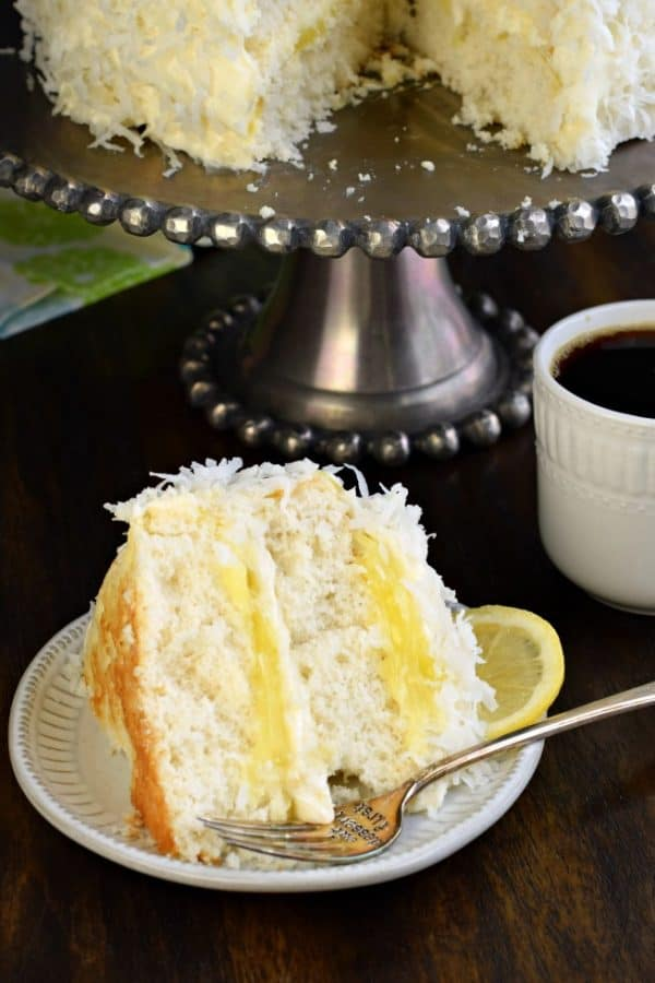 Lemon Coconut Cake filled with lemon curd and cream cheese frosting