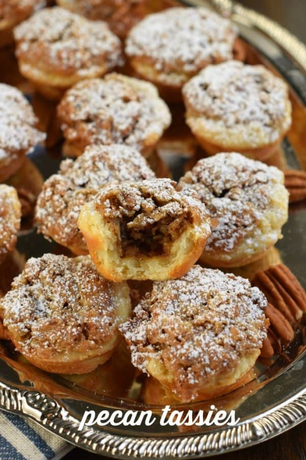 Delicious Pecan Tassies: mini pecan tarts. Flaky buttery cookie cups with pecan pie filling! #cookies