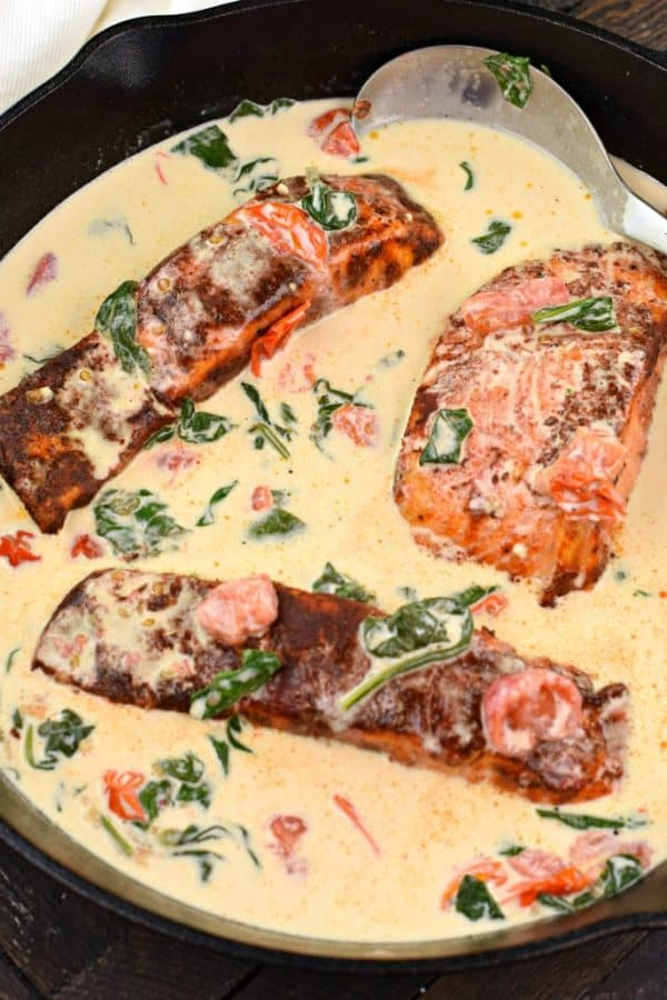 Blackened Salmon recipe in creamy, tuscan garlic sauce served over pasta!