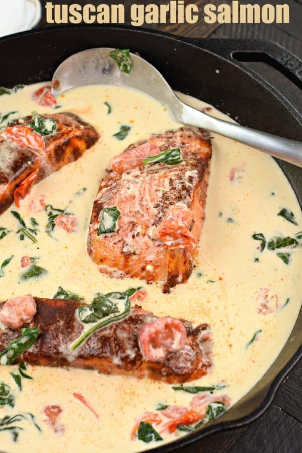 Tuscan Garlic Blackened Salmon served over pasta. Creamy sauce with spinach and tomatoes!