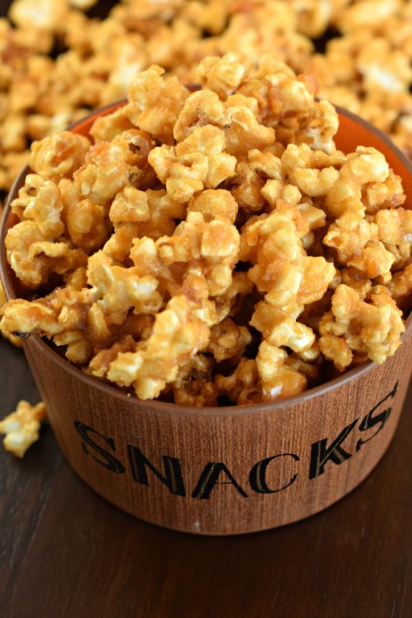 Sweet and crunchy, this Homemade Caramel Corn is the best ever, melt in your mouth treat! Perfect for your next movie night.