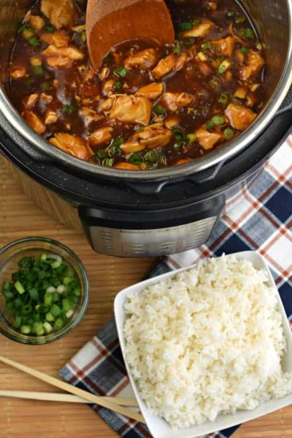 From start to finish, this easy Instant Pot Bourbon Chicken Recipe is ready in under 30 minutes! Packed with flavor, it's faster than going to the mall to pick up a plate of this dish! #chickendinner #chicken #instantpot #pressurecooker #weeknightmeal