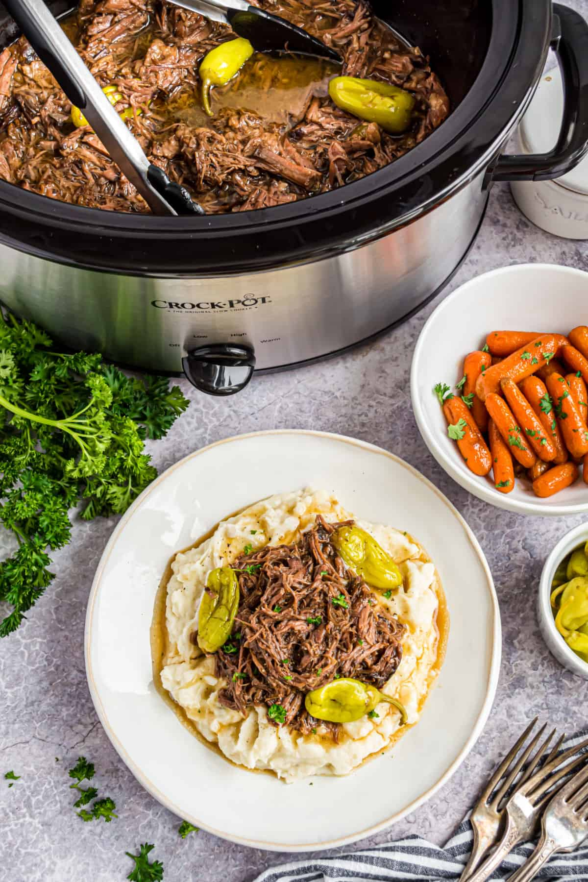 Mississippi pot roast served with mashed potatoes and carrots.