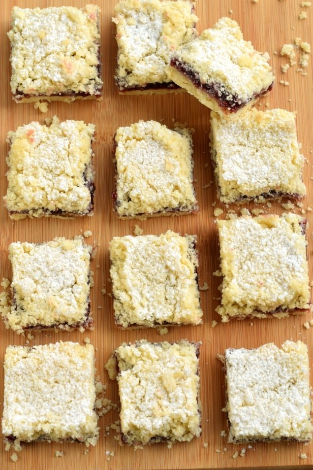 Raspberry cookie bars topped with powdered sugar.