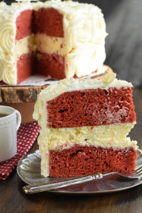 The BEST Red Velvet Cheesecake Cake recipe starts with two layers of homemade red velvet cake with a layer of cheesecake in the middle. Topped with delicious cream cheese frosting