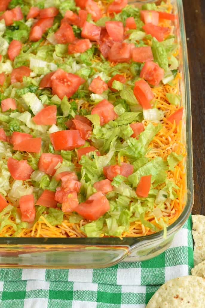 7 Layer dip topped with lettuce and tomato.