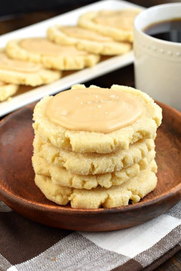 These Caramel Frosted Sugar Cookies are irresistible. Chewy sugar cookies with a no-chill dough topped with a sweet and salty caramel frosting! #sugarcookies
