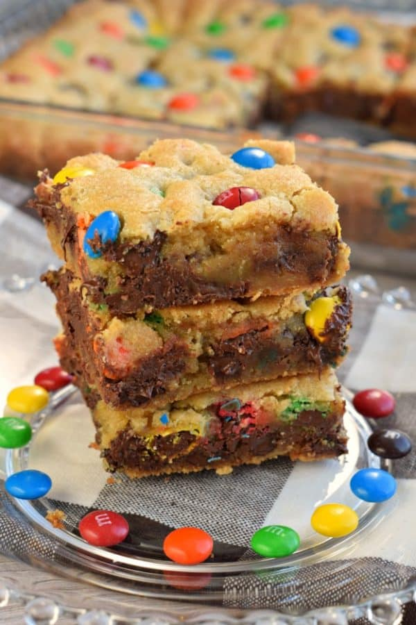 Chewy M&M's Chocolate Chip Cookie Bars are thick and delicious and perfect when you need a quick dessert. Perfect for holidays and bake sales too!