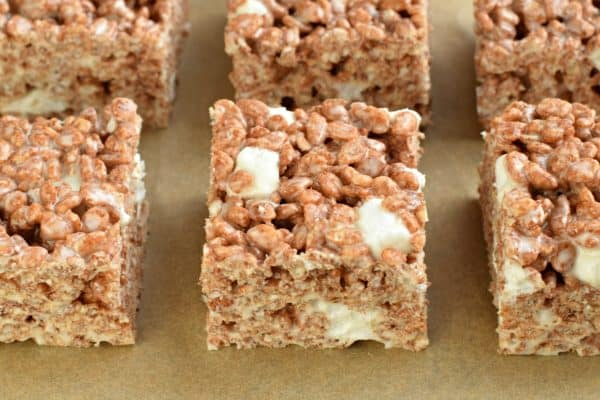 Get the tips and tricks to making the most PERFECT Cocoa Krispie Treats. Kid and adult friendly! THICK AND CHEWY!