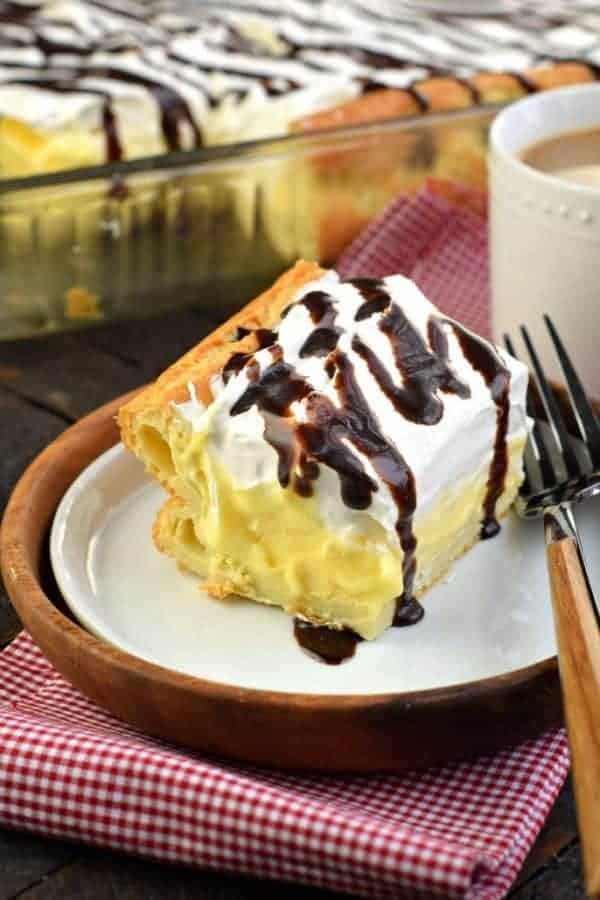 The Best Cream Puff Cake recipe featuring a fluffy crust, easy vanilla filling, and of course, chocolate. You'll love this homemade version of a cream puff!