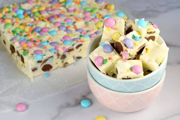 No matter the Spring holiday, this easy Easter Fudge recipe is perfect. Vanilla Fudge with pastel candies and sprinkles!