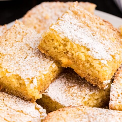 A St Louis tradition, this Gooey Butter Cake is simplified with it's easy cake mix option! Chewy Butter Cake crust with a gooey cream cheese filling!