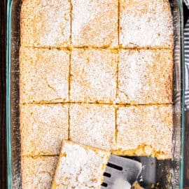 13x9 baking dish with gooey butter cake slices.