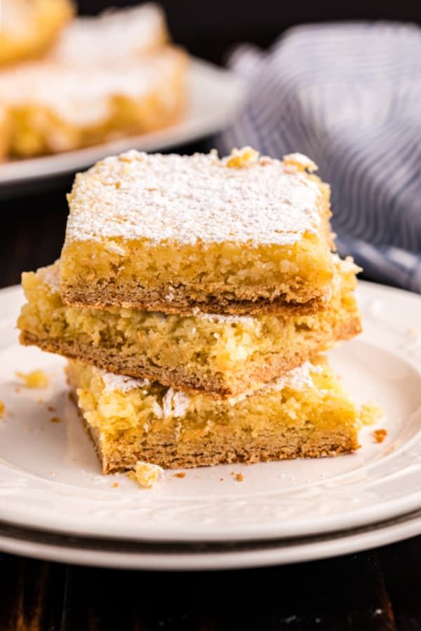 Gooey butter cake slices stacked on top of each other.