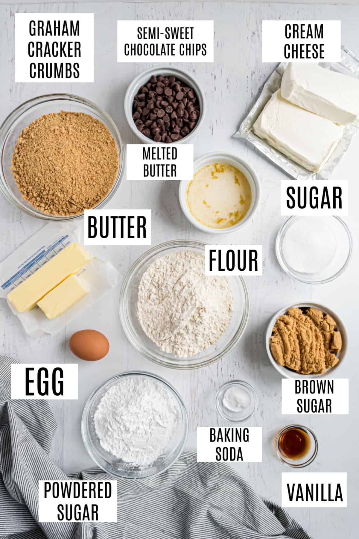 Ingredients needed to make chocolate chip cheesecake bars.
