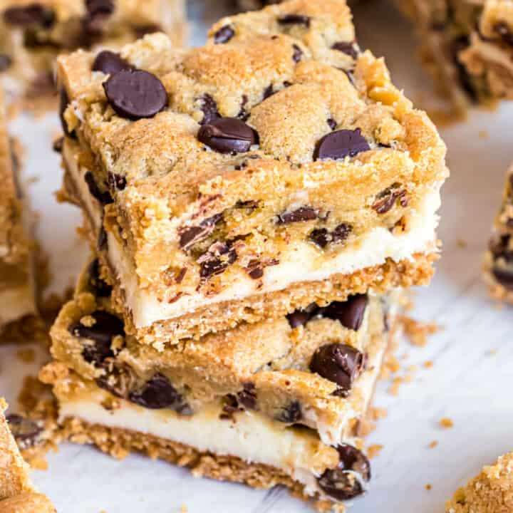 Chocolate Chip Cheesecake Bars with a graham cracker base, creamy cheesecake filling and delicious chocolate chip cookie crunch. These cold cookie bars are a perfect make ahead dessert!