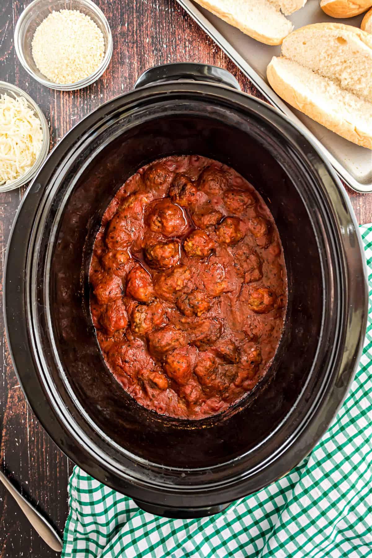 Meatballs in marinara sauce in crockpot.