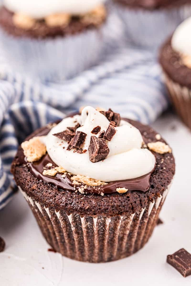 Chocolate cupcake topped with ganache, marshmallow frosting and graham cracker crumbs.