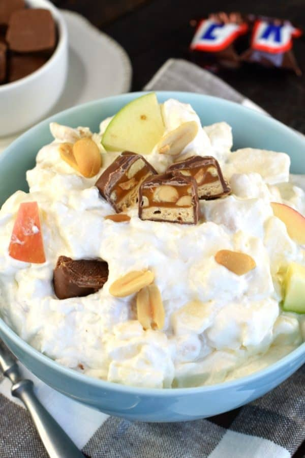 Snicker Caramel Apple Salad recipe is the perfect dessert for your next potluck. Whether serving this to your family or a crowd, it's always a 5 star recipe!