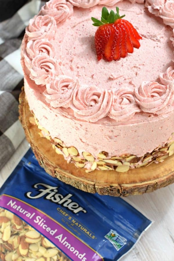 This gorgeous, from scratch, Strawberry Almond Cakerecipe features a moist almond layer cake with strawberry buttercream. Fresh sliced almonds and strawberries to added flavor and texture!